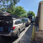 Loading Backpacks in Back Alley - 7 vehicles full